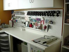 Pegboard+curtain rod+hooks= the possibility of organized crafting. The reality is probably something different...