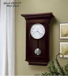 Chiming Black finish Quartz Wall Clock Howard Miller 625379 Gerrit-This fashionable wall clock has quality features. The white dial is surrounded by a brushed nickel bezel and offers embossed, brushed nickel Arabic numerals.