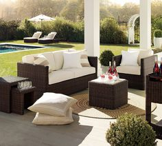Country backyard setting with wicker furniture.