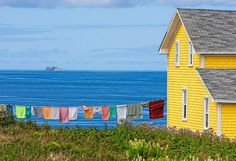 Apparently, this is the coast of France. Looks like Newfoundland Labrador, Canada Quebec, Jig Saw, Yellow Houses, Colorful Houses, Newfoundland And Labrador, Newfoundland Canada, Painting Inspiration, Photos, Pictures