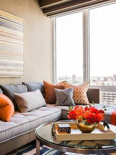Contemporary living room with burnt orange accents