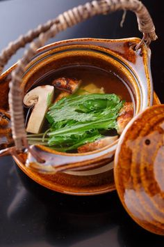 Dobin-mushi - a traditional Japanese seafood broth, steamed and served in a dobin tea pot with shrimp,chicken, soy sauce, lime, and matsutake mushroom.