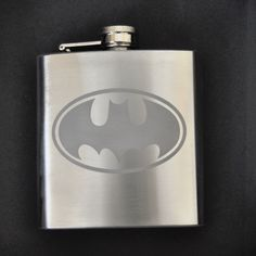A Batman flask makes a perfect groomsmen gift. [Etched 6oz Stainless Flask by Jackglass on Etsy. $17.95, via Etsy.]