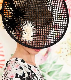Alannah Hill - available in store- Ginza By Ann Shoebridge $495.00 Hand blocked and wired hat in fishnet paper straw with hand sculpted and cut feather chrysanthemum trim. An Australia designer. perfect for the spring races!