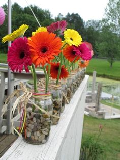 Beautiful gerbera daisies in a simple mason jar give my party a beautiful touch. Centerpiece flowers - Decoration For Home Gerbera Daisy Centerpiece, Flower Centerpieces, Wedding Centerpieces, Quinceanera Centerpieces, Table Centerpieces, Daisy Wedding, Wedding Table Flowers, Trendy Wedding, Wedding Reception
