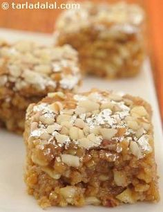 'Dry-Fruit Barfi' - A delicious sweet made of thickened milk and dry fruits flavoured with nutmeg and mace. By Tarla Dalal.These look amazing. Indian Dessert Recipes, Indian Sweets, Indian Snacks, Sweets Recipes, Cooking Recipes, Diwali Recipes, Indian Foods, Fruit Recipes, Indian Recipes