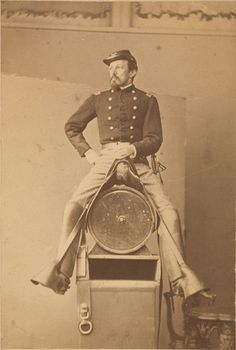 ca. 1860s, [albumen portrait of a staff grade Union cavalry officer seated on a saddle mounted on a barrel]. This is probably done for a painting or sculpture