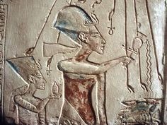 Relief showing Akhenaten and Nefertiti under the rays of the sun-god Aten. (Credit: CM DIxon/Print Collector/Getty Images)
