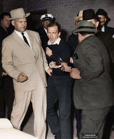 Shot and killed: Lee Harvey Oswald was an American sniper who assassinated President John F. Kennedy on November 22, 1963. In this photo, nightclub owner Jack Ruby (in the hat at right) shot and killed Oswald when he was being transferred from the Dallas police station to a nearby jail two days after killing the president
