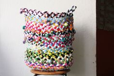 DIY t-shirt braided basket. Step by step directions. Not very hard but time consuming! Great for a kid's room!