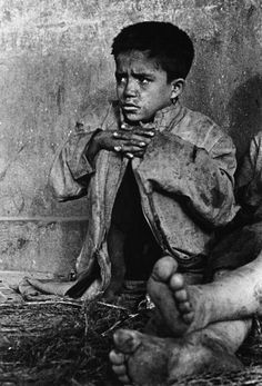 Sergio Larrain - Chile. Los Abandonados , 1957 -  They gather in clans, often run by older boys who holda homosexual hold over them. On the whole the street is fun for them, and they prefer that to the safety of state institutions. One of the children living around the Mapocho river and sleeping under bridges.