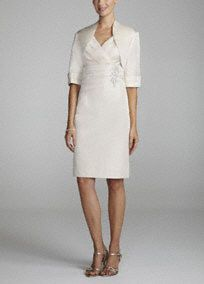 Traditional sophistication meets modern style in this exquisite Mother of the Bride ensemble!  Sleeveless bodice features elegant empire ruched waist thatcreates a flattering silhouette.  Side sparkling beaded detail adds dimension and drama.  3/4 sleeve jacket provides just the right amount of coverage.  Fully lined. Back zip. Imported poly/nylon/lurex blend. Dry clean only. Also available in plus sizes as Style 950937.