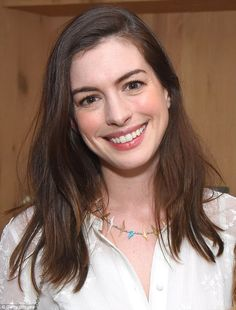 Anne Hathaway showed off her natural beauty Monday as she attended a book launch event in West Hollywood. (love her little bird necklace)