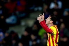 Lionel Messi of FC Barcelona celebrates scoring their opening goal during the Copa del Rey Round of 8 second leg match between Getafe CF and FC...