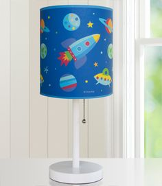 Olive Kids Out of this World Cylinder Lamp - 631411 $50 Brighten up your child's room with an Olive Kids lamp! Our wooden based, steel stemmed lamps are topped with a printed fabric lamp shade. Each lamp coordinates wonderfully with our bedding and other room d