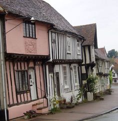 """Lavenham, Suffolk. Most people are drawn to this attractive Suffolk town by the profusion of half-timbered medieval cottages. Lavenham has been called """"the most complete medieval town in Britain"""", a tribute to its fine collection of medieval and Tudor architecture. Mansions of wealthy merchants mingle with simple cottages, some of which mix crooked timber beams with sprightly pink-painted infill! I worked here at a Solicitors office."""