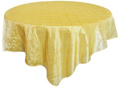 Yellow Pintuck Table Overlay provided by Waterford Event Rentals.