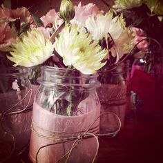 Flowers in a mason jar, sheer fabric wrapped in twine - Bridal shower decor. tissue paper instead of fabric?