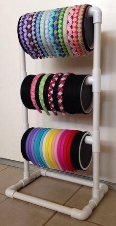 display with PVC pipe and oatmeal cans. Would be great for ribbon storage Pvc Pipe Storage, Ribbon Storage, Craft Storage, Storage Ideas, Storage Units, Headband Storage, Headband Display, Pvc Pipe Crafts, Pvc Pipe Projects