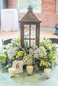 hydrangea centerpiece - photo by Emily Platt Photography http://ruffledblog.com/high-tide-inspired-wedding-in-greenville