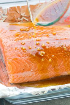 The best easy oven baked salmon recipe! The salmon is cooked in a honey garlic sauce that is so flavorful! How to cook salmon in the oven plus ideas for sides to go with salmon. This baked salmon is one of our favorite healthy dinner recipes! Salmon Filet Oven, Oven Cooked Salmon, Baked Salmon Filets, Salmon Cooking Time, Honey Baked Salmon, Oven Roasted Salmon, Baking Salmon In Oven, Smoked Salmon, Salmon With Skin Recipes