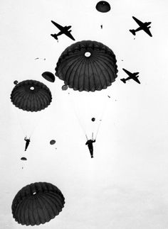 Paratroopers from the 1st Canadian Parachute Battalion of the 6th British Airborne Division drop over Salisbury Plain, England, from Douglas C-47 Dakota aircraft  - 6 February 1944