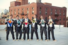 Is your husband-to-be a comic book nerd? Let him release his inner super hero by wearing superhero shirts underneath their tuxedos. Such a great photo op.