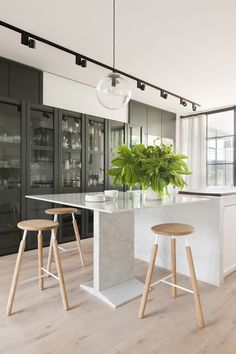 Casual dining off the main kitchen island - wonderfully minimalistic table and stools