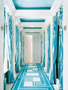 CONTEMPORARY ENTRANCE HALL BY DIAMOND BARATTA DESIGN In a Florida beach house, the entry hall's palette is pared to white and turquoise. The runner and portieres are custom made.