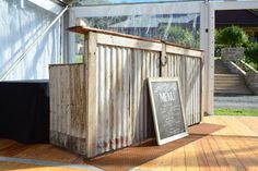 Made from corrugated iron, recycled timbers and horseshoe adornment, our rustic Bush Bar is perfect for any country styled event. Hire Bush Bar: Your Event Solution Corigated Metal, Metal Bar, Patio, Backyard, Bar Hire, Chicago Bars, Corrugated Tin, Outside Bars, My Pool