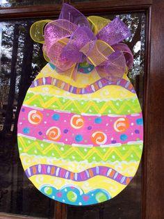 Wooden Easter egg door hanger by designsbyhadley on Etsy, $36.00