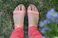 Pale orange sandals and salmon jeans.