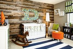 "Little Man Sophistication--natural wood wall; oversized monogram over crib; colors (navy, orange, green); rocking horse; wall art; and ""small touch"" decor."