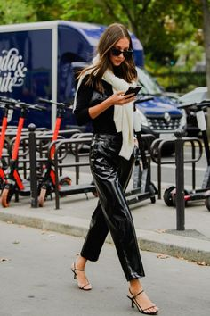 Stylish street stule outfit inspiration with patent leather pants and sweater tied over the shoulders — discount codes for fashion black friday and cyber modnay salsa from nordstrom, shopbop and more