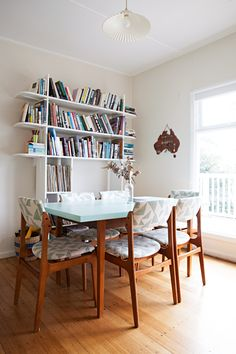 Shop Dulux Mobile Paint Colour Vivid White, Similar: One Two Tree My Treasure Board – Australia, Similar: Turin Wood Dining Table or Oversized Work Table With Farmhouse Legs Overstock.com, Similar: CB2 3.14 white bookcase, Similar: West Elm Tate Upholstered Dining Chair, Similar: Anthropologie Hector Pleat Pendant, Similar: SVÄRTAN Decorative bottle - IKEA, Similar: Far & Wide Collective Royal Blue Striped Basket - Kenya and more