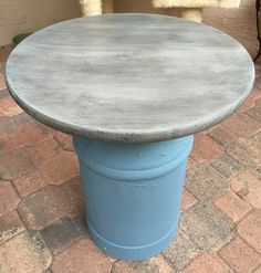 Milk can table painted with Annie Sloan coco and old ochre. Aubusson blue and old white wash and then applied black wax.