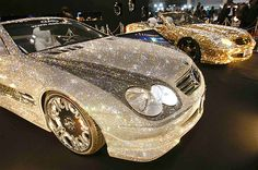 Customized Mercedes-Benz SL600s, studded with 300,000 Swarovski Crystal glass, are displayed at the pavilion of custom car accessory company Garson/D.A.D at Tokyo Auto Salon 2010 at Makuhari Messe in Chiba, east of Tokyo