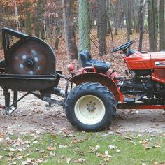 Small tractor with mounted log splitter or buzz saw and wood wagon make for an all in one wood-cutting rig that would serve any homesteader well.data-pin-do=