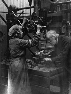 MINISTRY INFORMATION FIRST WORLD WAR OFFICIAL COLLECTION (Q 20101)   A women worker operating a magazine drilling plate in Shipbuilding Yard of Messrs. Swan, Hunter and Wigham Richardson, Wallsend.