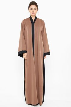 A casual brown knitted abaya.The abaya comes with a matching sheila.Made with Fine Georgette.