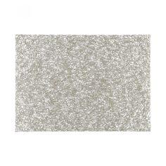 Mantel Chilewich confeccionado en material sintético color dorado con forma rectangular y diseño entrelazado.