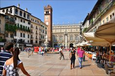 Piazza delle Erbe in Verona. This is a lovely place to relax despite the market and general hustle and bustle. The Piazza delle Signori, through an arch to the right, is also a lovely place to be.