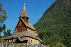 URNES STAVE CHURCH, Norway: was built about 1132. It provides a link between the architecture of the Viking Age, with typical animal ornamentation, & Christianity, which was introduced into Norway during the reign of St Olav just prior to the building of this church. The church sits in a glacial valley directly across a fjord from the village of Solvorn & about 3.1 mi from the village of Hafslo.
