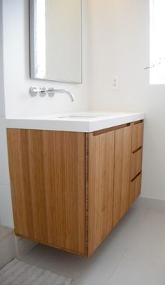 modern bathroom vanity done with bamboo and top mount sinks. www