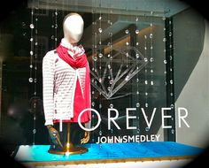 Diamonds are Forever at John Smedley, Brook Street, London. Celebrating the Queen's Diamond Jubilee with sparkle garlands and a bespoke frosted fret-cut diamond.