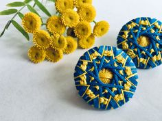 2 earrings made from dorset buttons, in blue and yellow Dorset Buttons, Jewelry Accessories, Unique Jewelry, Yellow, Blue, Something To Do, Crochet Earrings, Etsy Seller, Colorful