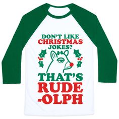 """Bring all of your best dad jokes to the family party this holiday season. This holiday design features the text """"Don't Like Christmas Jokes? That's Rude-olph"""" with a grumpy Rudolph illustration. Perfect for Christmas dinner, holiday parties, and pun lovers."""