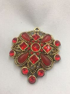 Pendant Red Stones Costume Jewelry Excellent Condition    eBay. It's available in my eBay store a Picker's paradise sc & also in my brick & mortar store A Picker's Paradise located @ 12 Mill Street in down town Inman, sc. We are also on Facebook.
