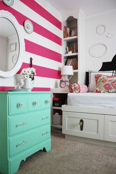 Beautiful Pink and White Striped Little Girls Bedroom Idea with a gorgeous turquoise dresser. Meet Kelle and Nick, recently featured on a Home Tour for Apartment Therapy