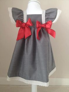 Love the bows and ruffle sleeves.  (by sal & pimenta)